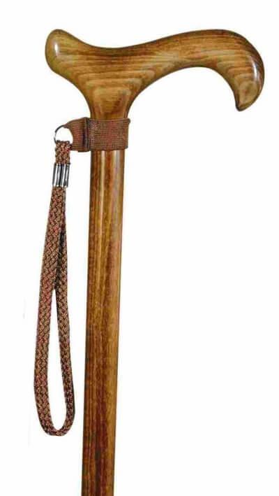 Håndledsrem til stok i brun farve, her vist på en træstok med derbygreb